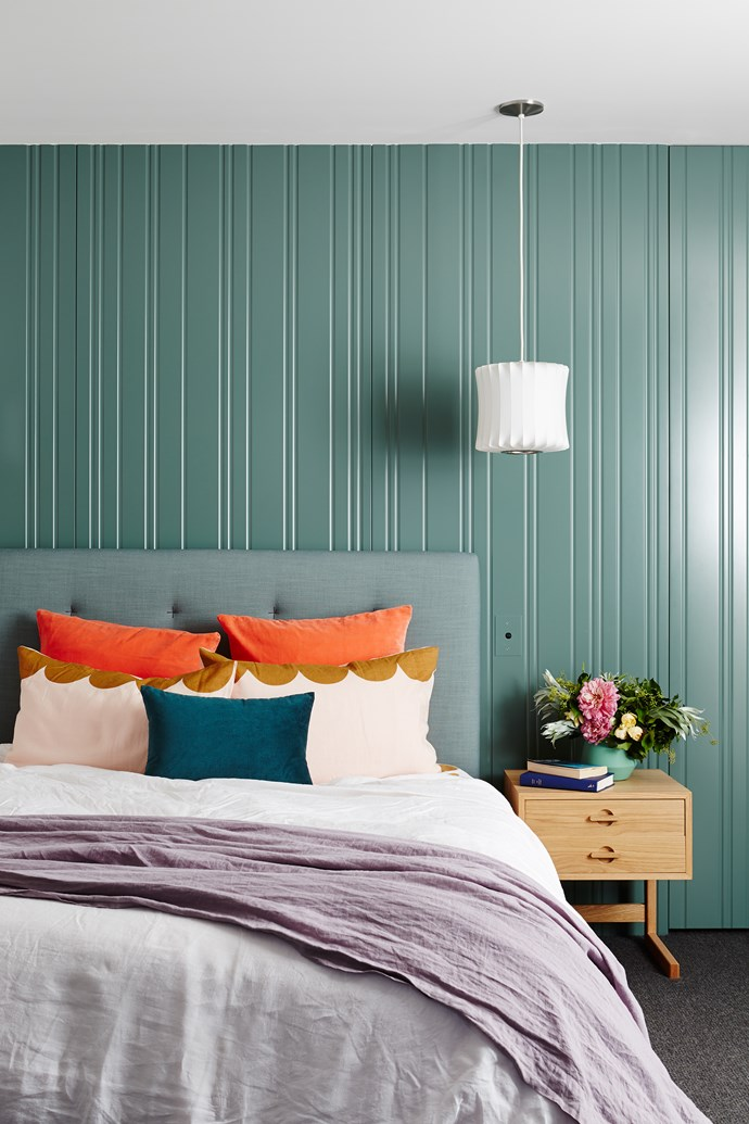 Spray-painted Dulux Urban Garden, the wall of custom-routed MDF panels adds much-needed texture. European pillowcases and scalloped pillowcases, from Castle. Cushion and vase, from Simple Form.