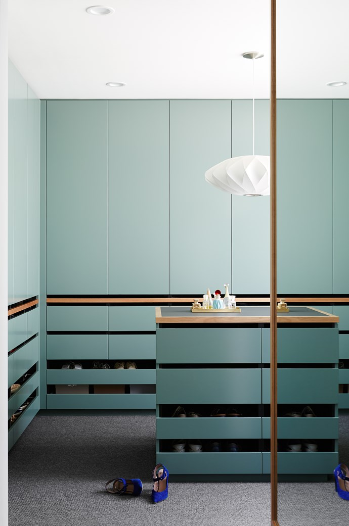 Wall-to-wall storage and an elegant George Nelson 'Saucer' light from Lights Lights Lights have transformed a too-small bedroom into a dressing room to die for.