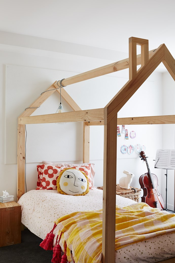 An oversized pinboard is hung behind the bed, ready to be filled with made and collected treasures. For similar bed, try This Little Love. Throw, from Kip & Co.