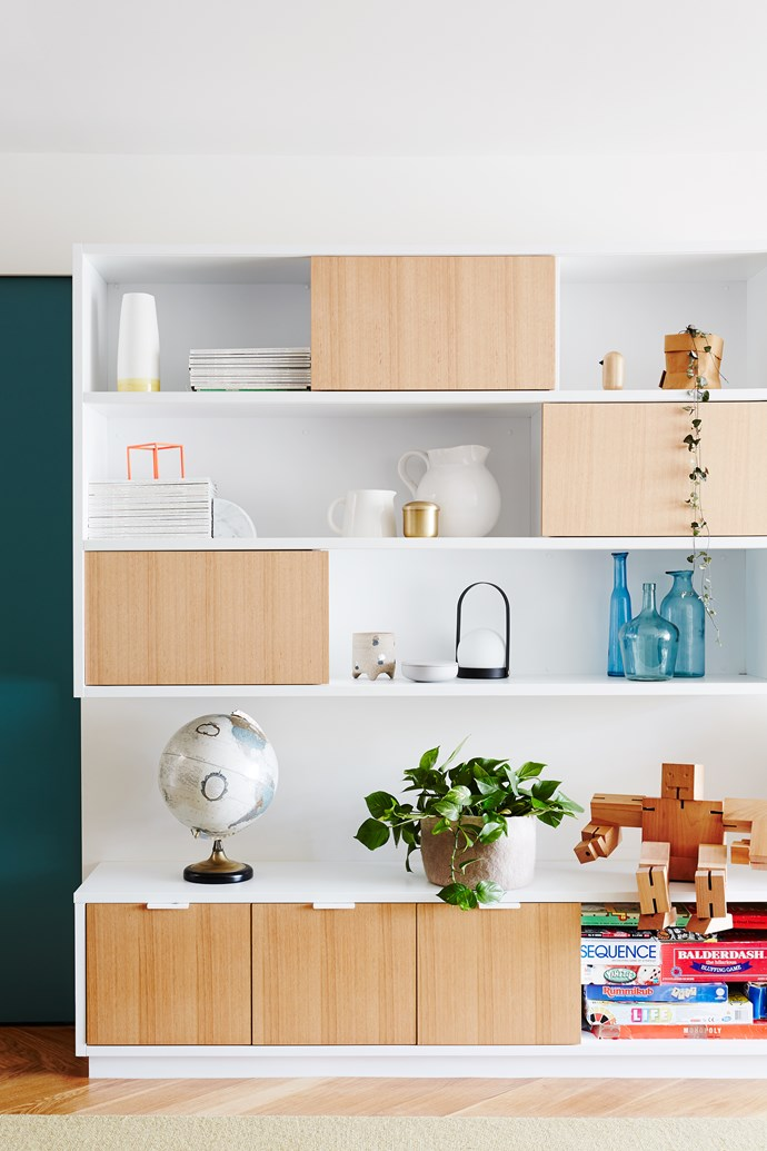 A built-in storage unit painted Dulux Lexicon keeps clutter contained in the family room.