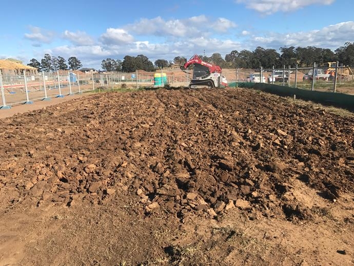 """**AUGUST 7, 2017: AND WE'RE BUILDING!**  <br><br>  The bobcats are busy at House & Garden's My Ideal House site - putting the finishing touches on the earthworks at Crest by Mirvac in Sydney's Gledswood Hills so the site is perfectly level. <br><br>  """"We use GPS technology to ensure everything is precise,"""" says Ricardo Awad, project coordinator of Masterplanned Communities, Construction, for Mirvac. """"Once we're happy with its accuracy the concrete work will begin, probably within the next day or two."""" <br><br>  This next step in the process is the piering. """"This involves us drilling holes in the ground for the house's concrete footings,"""" says Ricardo. """"When these are all in place in we leave them to cure and set."""" <br><br>  The curing process can take approximately a week, after which time the slab for the house can be poured and the first sections of the frame can go up. <br><br>  """"Before the concrete is poured we get the plumbers in to run their pipework externally, out to the stormwater drains,"""" he says. """"We also have an electrician come in at this point, to lay some preliminary wiring."""""""