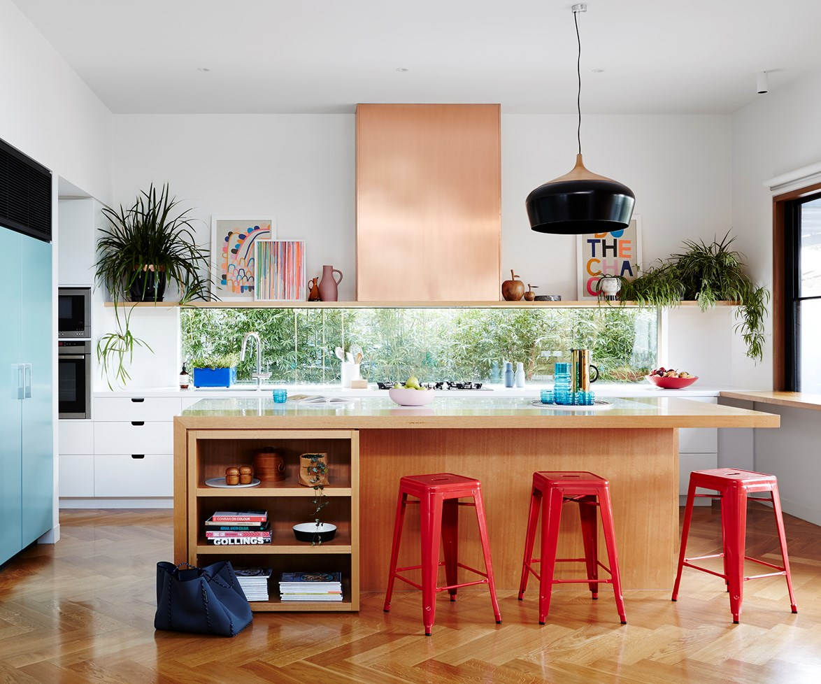 In this [modernist home in Melbourne](http://www.homestolove.com.au/renovated-modernist-melbourne-home-5581), the Victorian Ash kitchen island provides contrast against the sleek white rear cabinetry while anchoring the room's vibrant pops of colour. *Photo: Annette O'Brien / Australian House & Garden*