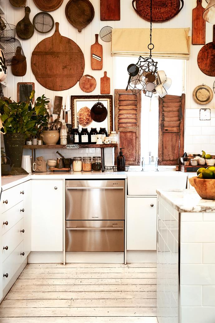 To offset the expense of the Calacatta marble island in the kitchen, Kara chose Laminex in Snow White for the other benchtops and affordable white subway tiles for the splashback. The kitchen highlights Kara's love of collecting vintage utensils and wooden boards bought on her travels.