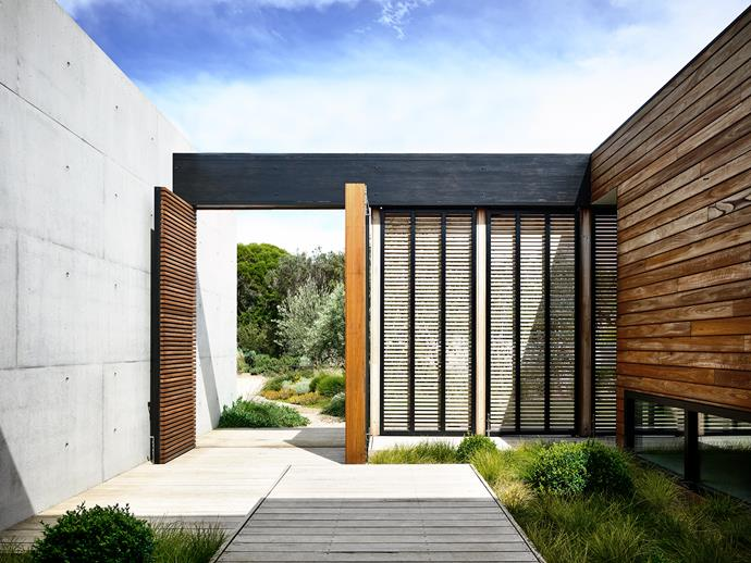 """""""A slower pace of life on the peninsula and the relaxed lifestyles of the residents are replicated in the modest and soft nature of the landscape that envelops the home,"""" says landscape architect Brett Robinson of the sun-drenched property."""