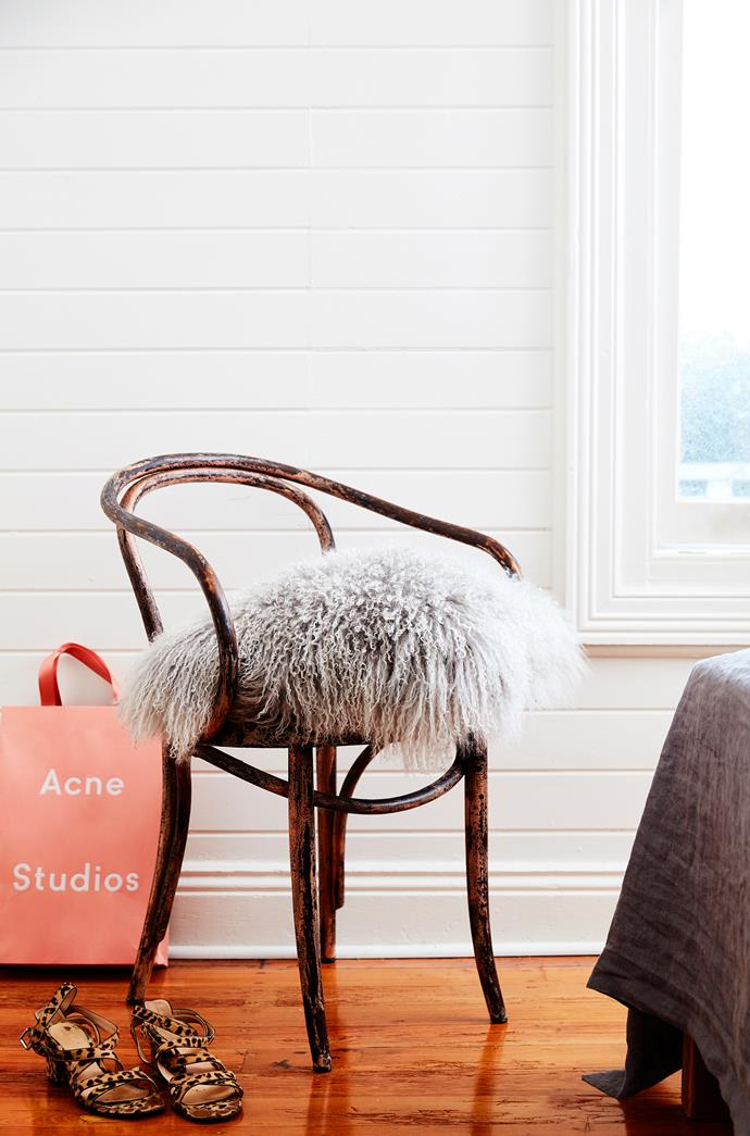 A faux fur cushion adds a touch of luxe to Alexandra's bedroom chair.