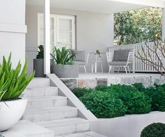 Sloping coastal garden by Secret Gardens
