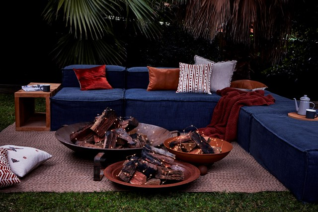 Fairy lights make for a cosy get-together around the firepit.
