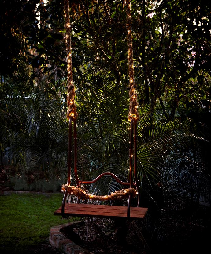 Handmade copper swing, $450, The Society Inc. LED twinkle lights, $5, Kmart.