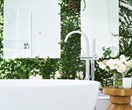 A white bathroom with its own courtyard
