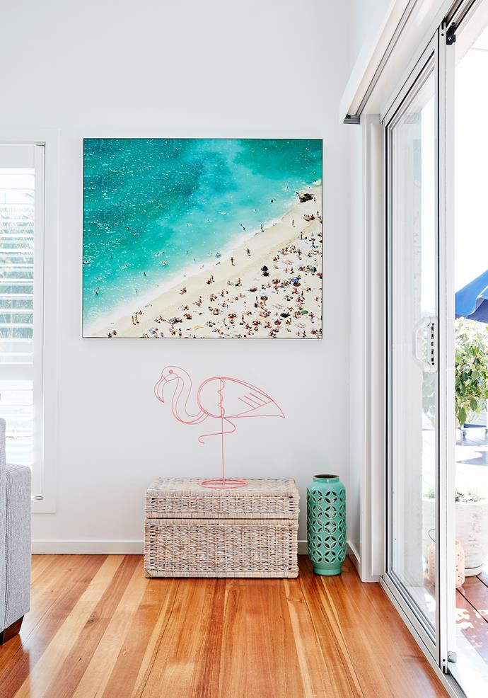 These decor pieces reflect the pops of pink a ocean blues in the artwork.