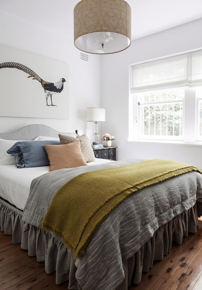 Muted pastel tones add a soft touch of colour to this neutral bedroom.