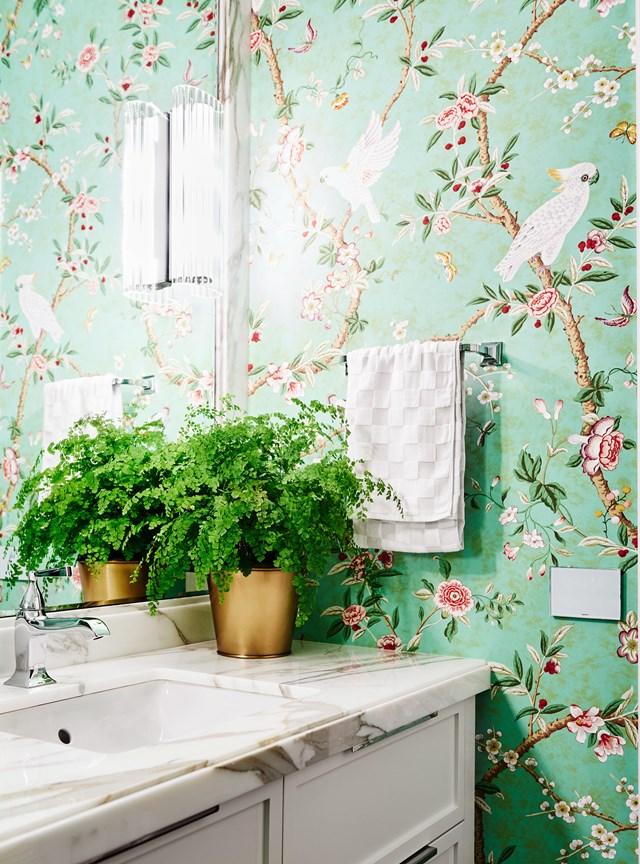Eye-catching and uplifting, this emerald-green, floral wallpaper paired with simple yet classic bathroom fixtures, instantly modernises the interior of this [Georgian brick home](http://www.homestolove.com.au/1930s-georgian-brick-home-honours-late-designers-vision-5654). *Photo: Lisa Cohen / Belle*