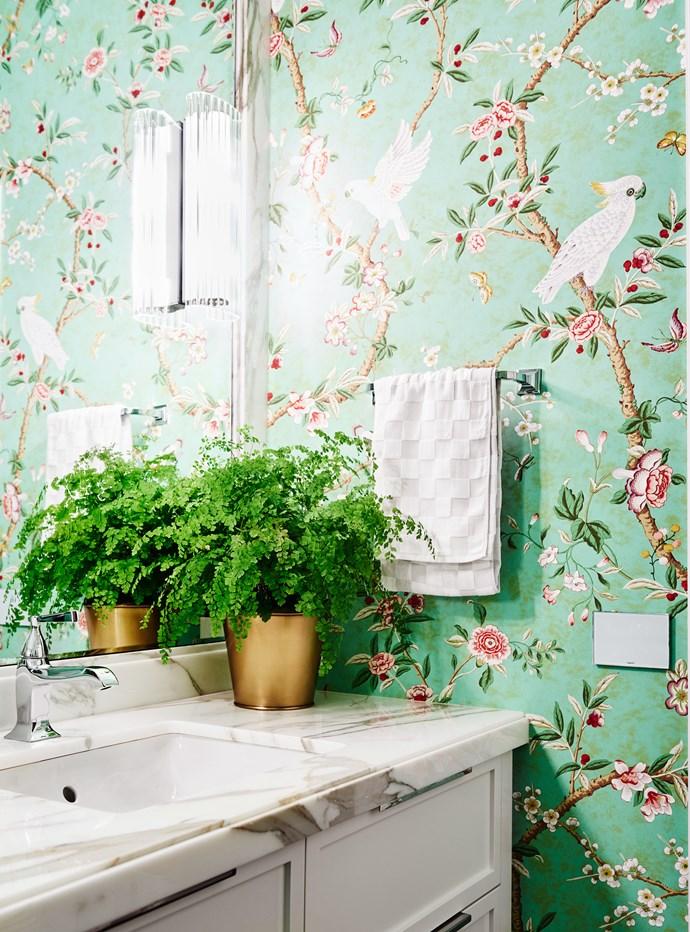 Brunschwig & Fils 'Kanchou' wallpaper in the bathroom. Calacatta 'Moonlight' marble. Wall light is from Custom Lighting.