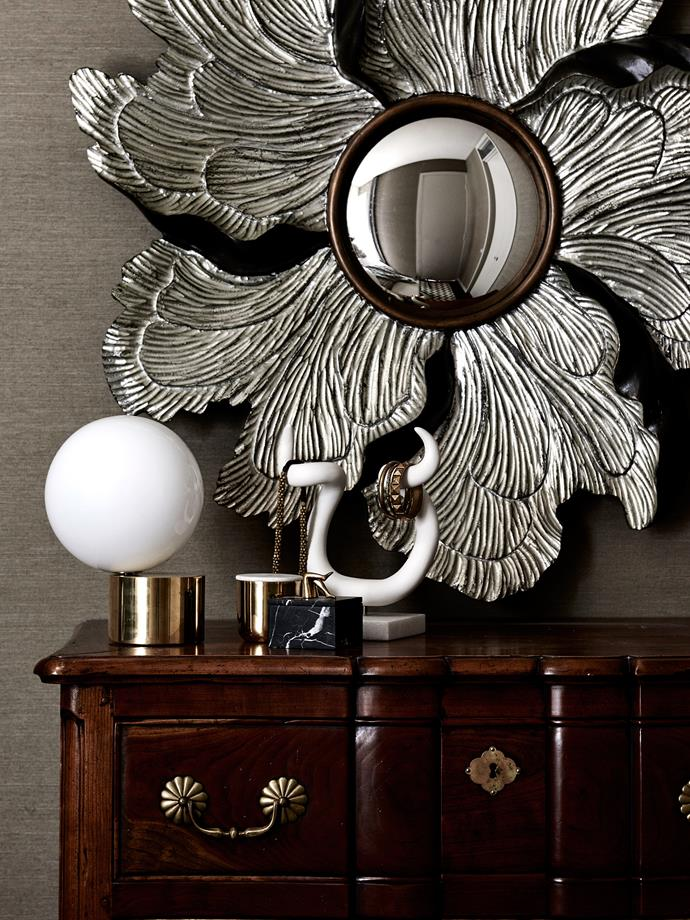 In the bedroom, Baker 'Petalo' mirror from Cavit & Co, Jonathan Adler horns from Coco Republic, and Michael Anastassiades lamp from Hub.