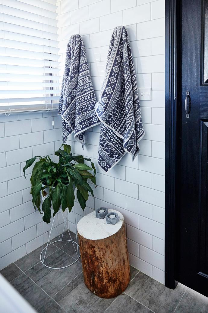 A simple log from the backyard, the top painted white, makes a great bathroom stool.