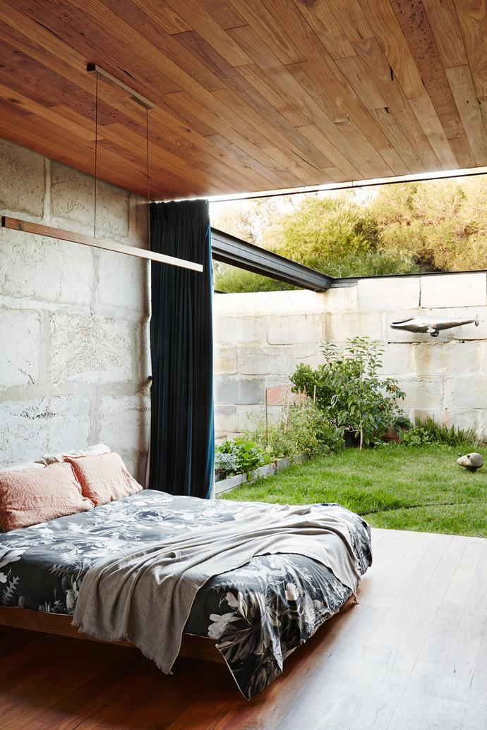 Sharing the home's single bedroom works well for the young family. It opens to an enclosed courtyard with thriving kitchen garden, which they all keep an eye on.