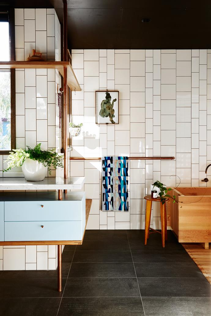 """Bath, joinery and furniture by Form Architecture Furniture. The cabinet fronts are melamine; the benchtop is Carrara marble. Wall tiles, [Johnson Tiles](http://www.johnsontiles.com.au/ target=""""_blank"""" rel=""""nofollow""""). Floor tiles, [Cerdomus Tile Studio](https://www.cerdomus.com.au/ target=""""_blank"""" rel=""""nofollow"""")."""