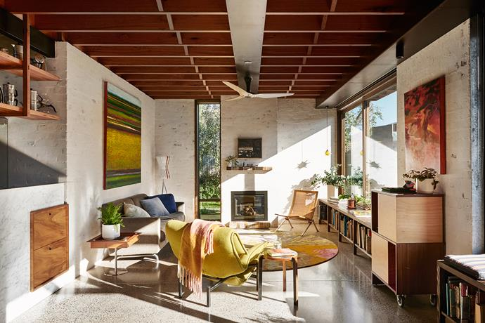 Layers of texture – plastered brick walls, exposed beams and concrete flooring – combine with vintage furniture in an inviting interior. Paintings by (from left) Patrick Grieve, Rick Amor and Edwin Gardiner.