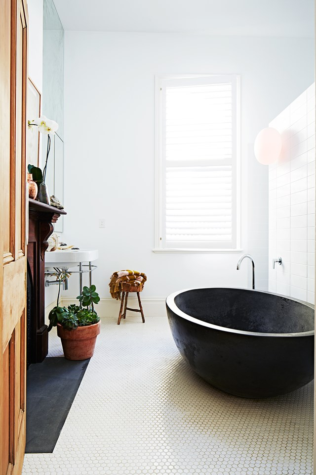 "The former living room of this [Melbourne terrace](https://www.homestolove.com.au/restoration-and-extension-of-victorian-terrace-5704|target=""_blank"") was turned into a large bathroom complete with reconditioned original fireplace. Photo: Armelle Habib"