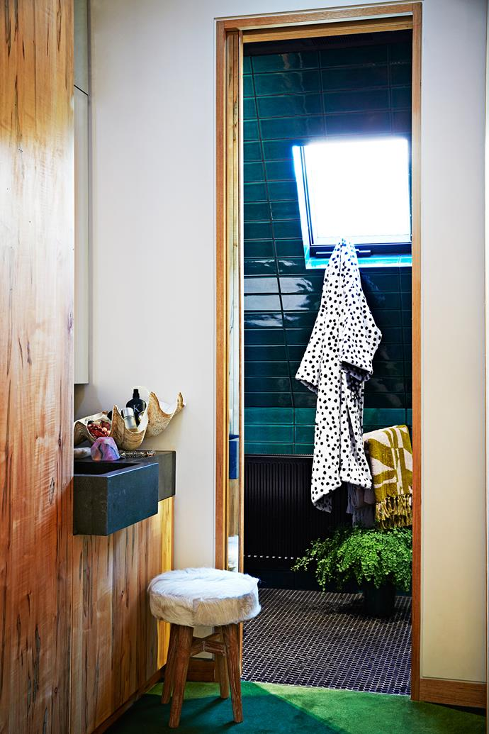 The master bedroom ensuite is decked out with green Italian glazed ceramic tile from Perini, and fitted with a black De'longhi hydraulic panel heater. The bathrobe and towel are from Kip & Co.