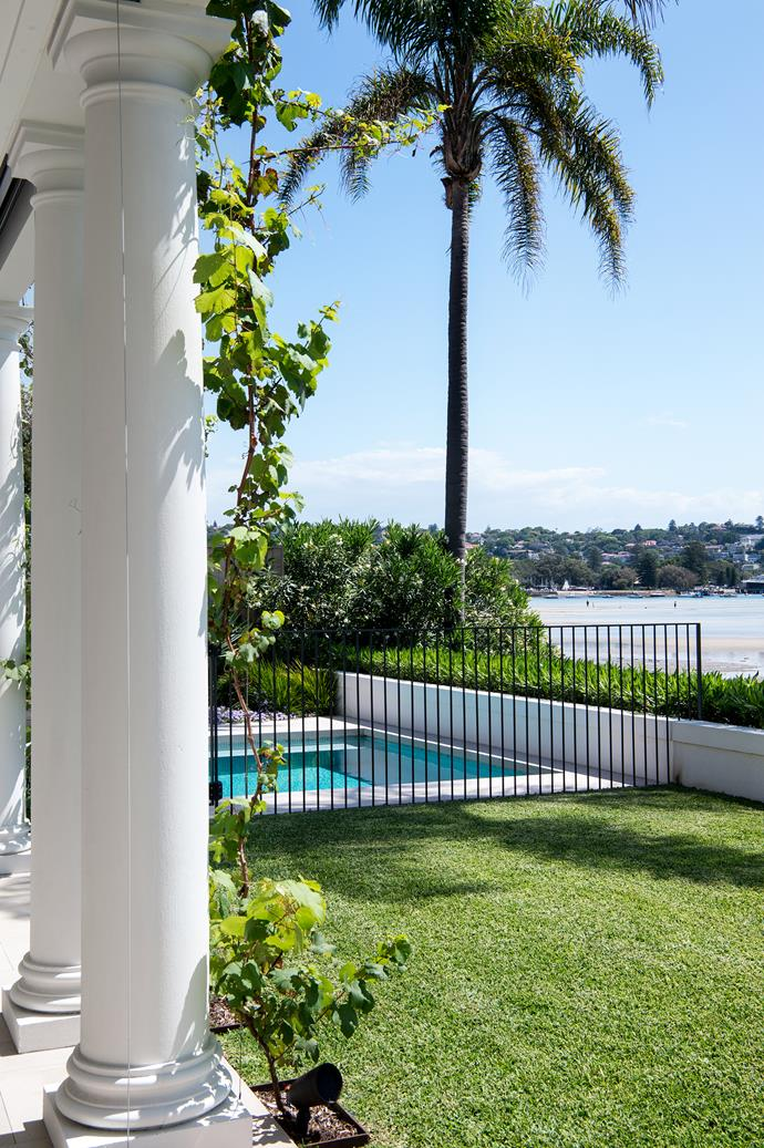 The pool sits between the house and the harbour.