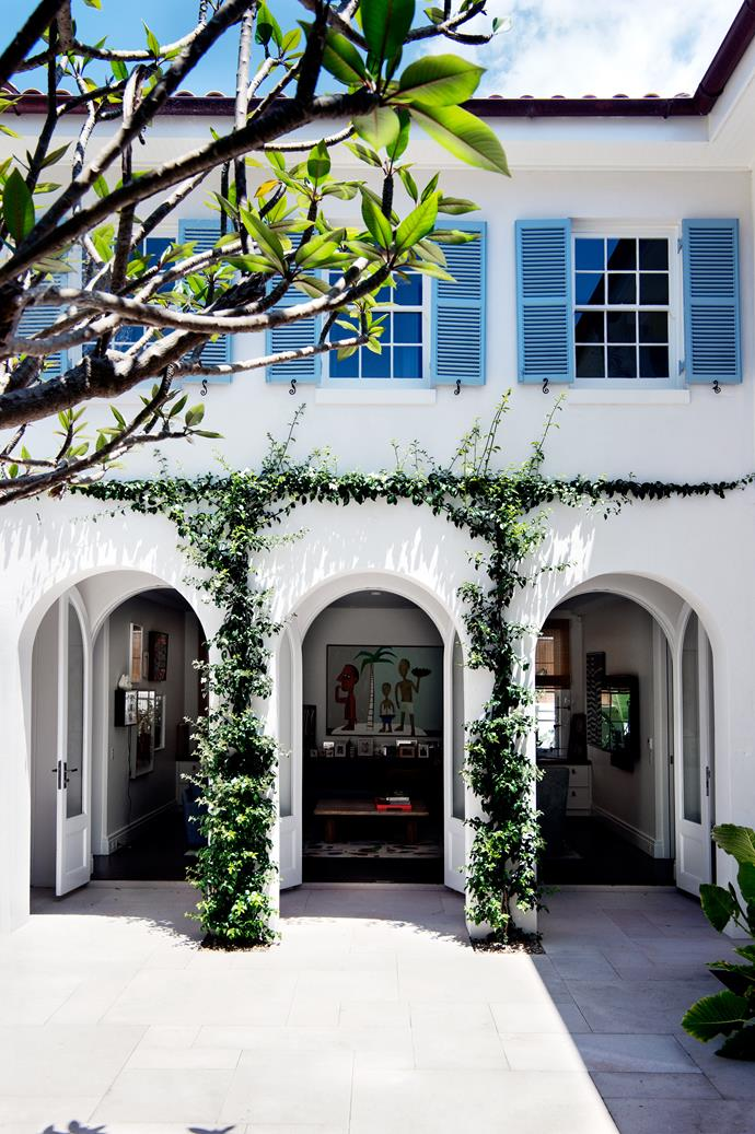 Arches and curved windows and doorways are a significant architectural feature of the house. Artwork by Robert Ryan.