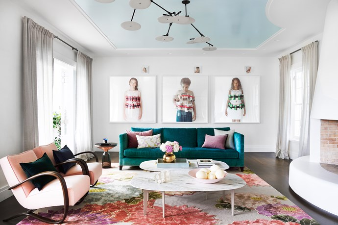 The main living room combines pieces designed by Briony Fitzgerald including the sofas and coffee table, alongside refurbished vintage finds.