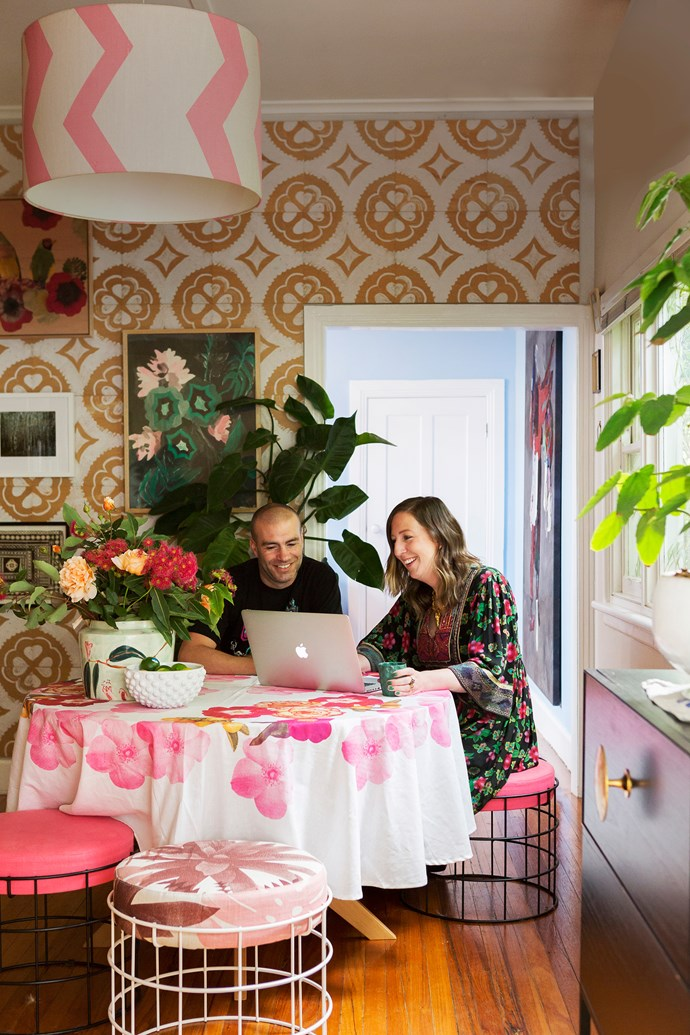 **7.30AM, AT HOME IN BRUNSWICK WEST, MELBOURNE** After taking her dogs for a walk, Bonnie returns home and attends to emails. Here, husband Neil joins her in the living room. Naturally, it's a showcase for their wares, including a 'Sicily' tablecloth and 'Dahlia' wall tiles.