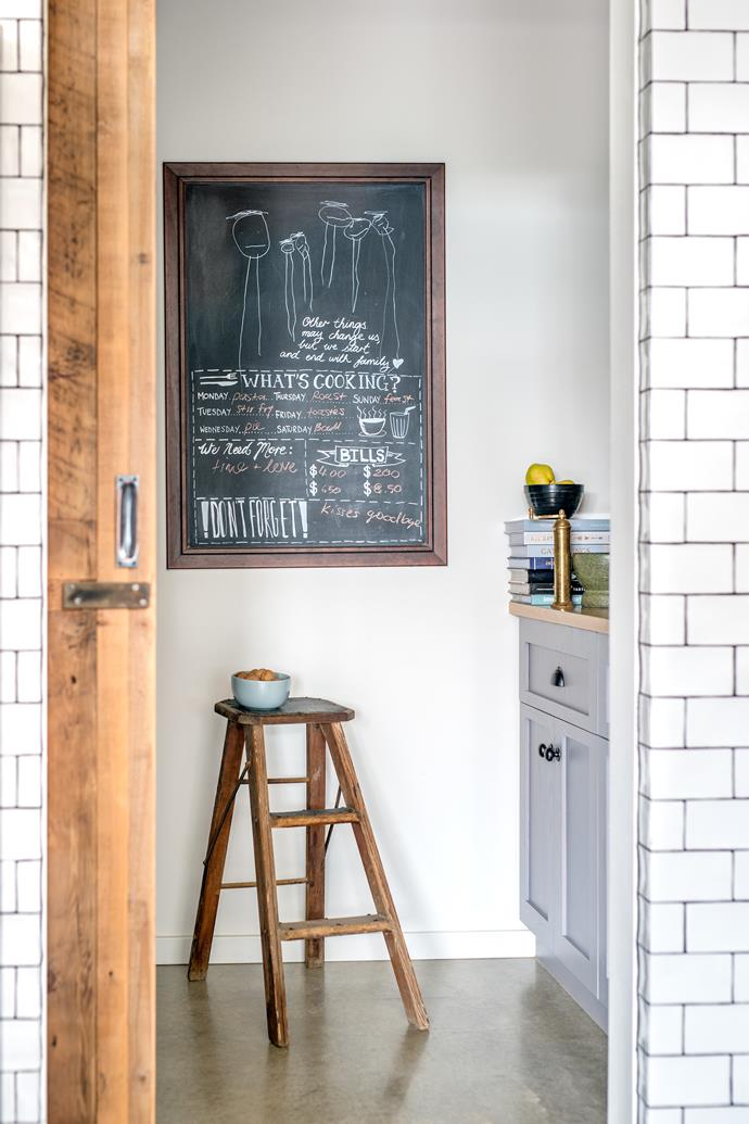 A barn-like sliding door made from reclaimed oregon leads to the pantry.