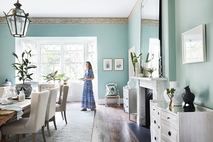 An exquisite wallpaper frieze runs under the cornice. Anna designed a suitably grand mirror to preside over the fireplace. Table and pendant light, from The Country Trader. Chairs and chests, from Villa Maison.