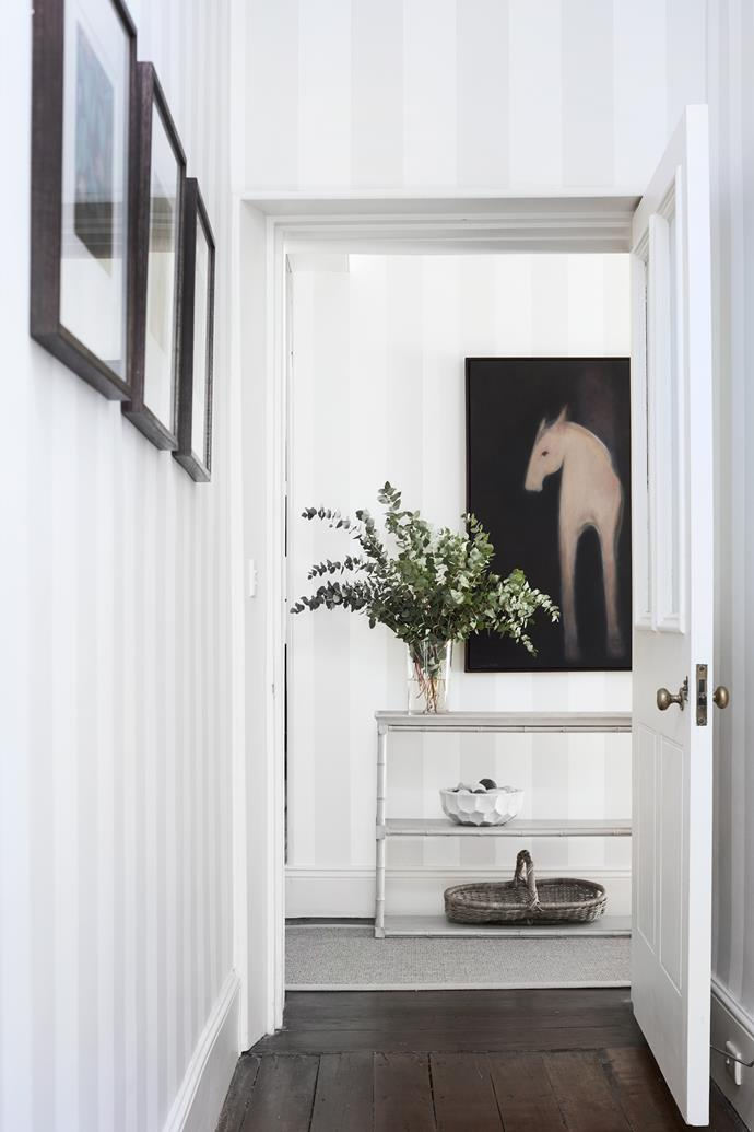 A work by Susan Parker dominates the view from the dining room, with real greenery to tempt the painted horse.