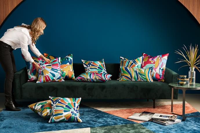 Kate arranges her debut collection of cushions.
