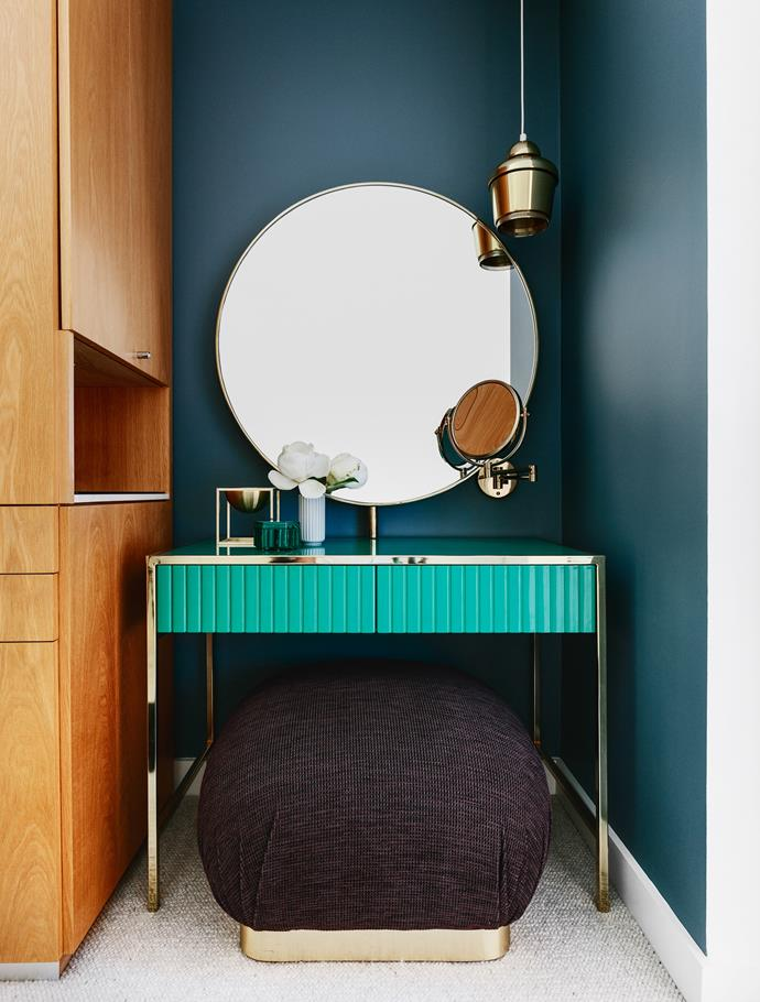 Custom-designed dressing table in emerald green lacquer with brass detailing.