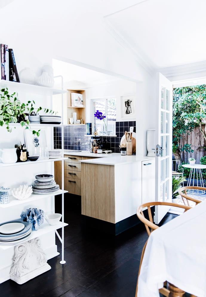 The light-filled kitchen and dining zone opens on to a lush, leafy courtyard.