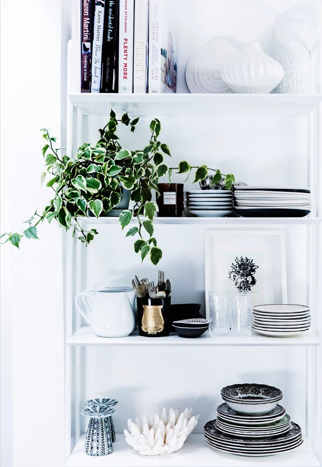 """A selection of vases from Jonathan Adler sit at the top of a shelving system from Blu Dot in this [stylish Bondi home](https://www.homestolove.com.au/interiors-stylist-kirsten-bookallils-beautiful-bondi-home-5753