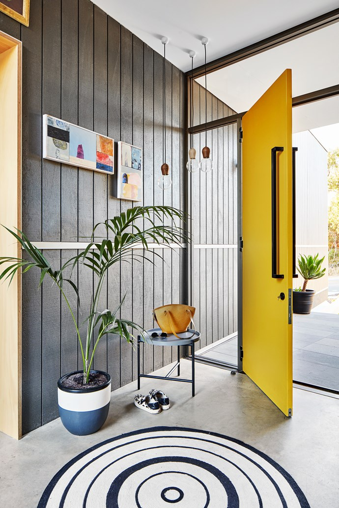 "We were unconvinced to start with,"" says Dylan of the bright yellow accents featured throughout the home, ""but then we thought, if anything could tie into the coastal setting, it would be that yellow sand colour."""