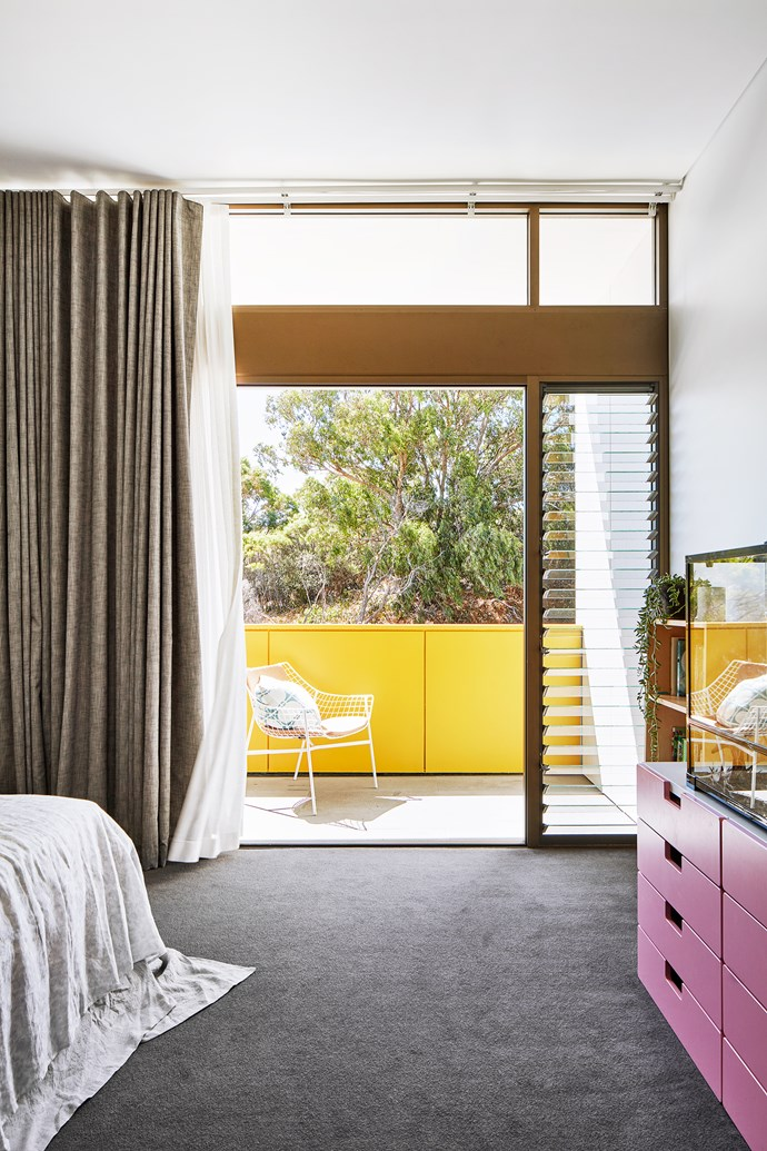 Sliding doors and louvres make the rooms feel private yet connected.