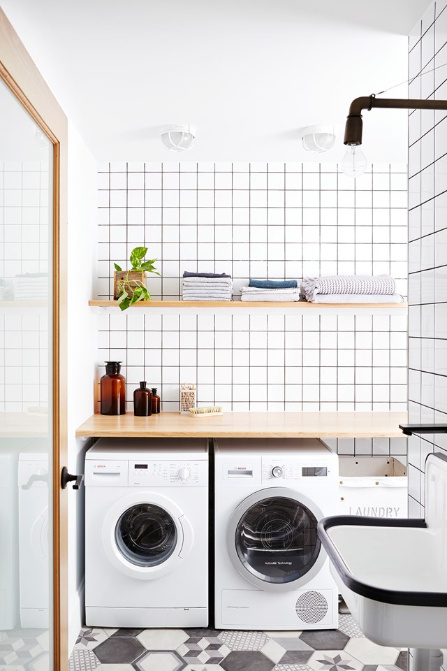 It may be simple but this laundry is bursting with pretty and practical design ideas. Open shelving allows you display decorative items such as indoor plants and your *good* towels, while baskets for dirty laundry baskets are neatly tucked away under the bench. Photo: Annette O'Brien.