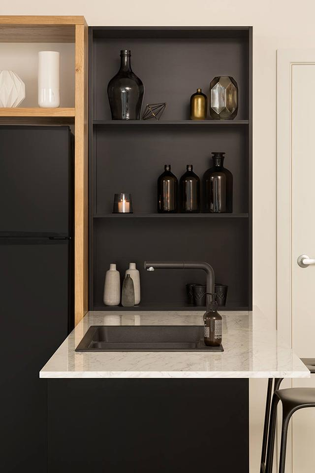 Thanks to new technology innovations, laminate benchtops can give kitchens a sleek, modern finish at an affordable price point. *Photo: kaboodle kitchen*