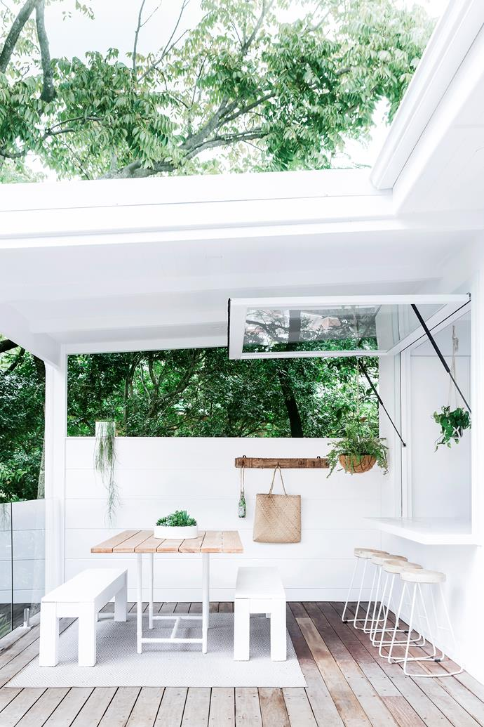 The team renovated Lana's family home in Northbridge, NSW. In the outdoor space, the white and timber theme is continued from the interior. The table is from Alboo, the stools from Oz Design Furniture and the outdoor rug is from Zanui.