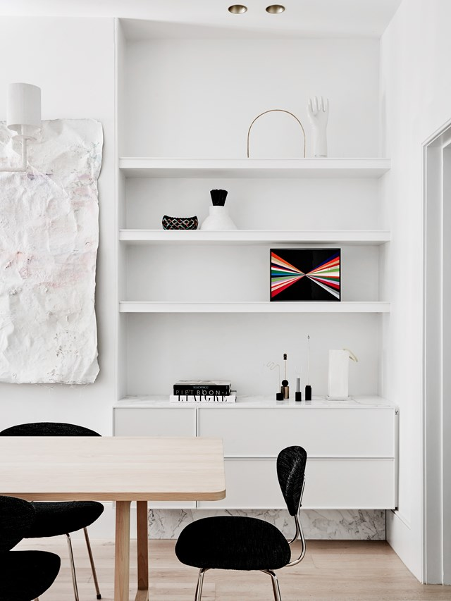 "Creating a minimalist home doesn't mean keeping absolutely every item stored out of sight. Think of the room as a gallery to display only the most beautiful things, and keep items carefully curated. This built-in shelving in the dining room of a [renovated terrace house in Melbourne](https://www.homestolove.com.au/terrace-renovation-melbourne-by-flack-studio-5781|target=""_blank"") is the perfect example. *Photo: Brooke Holm / Belle*"
