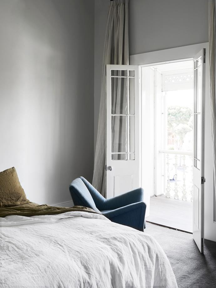 In the main bedroom a Gio Ponti-inspired vintage chair from Cabinet de Luxe sits ready for taking in the views.