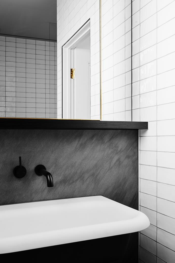 Black fittings add a slick of shine to the bathroom.