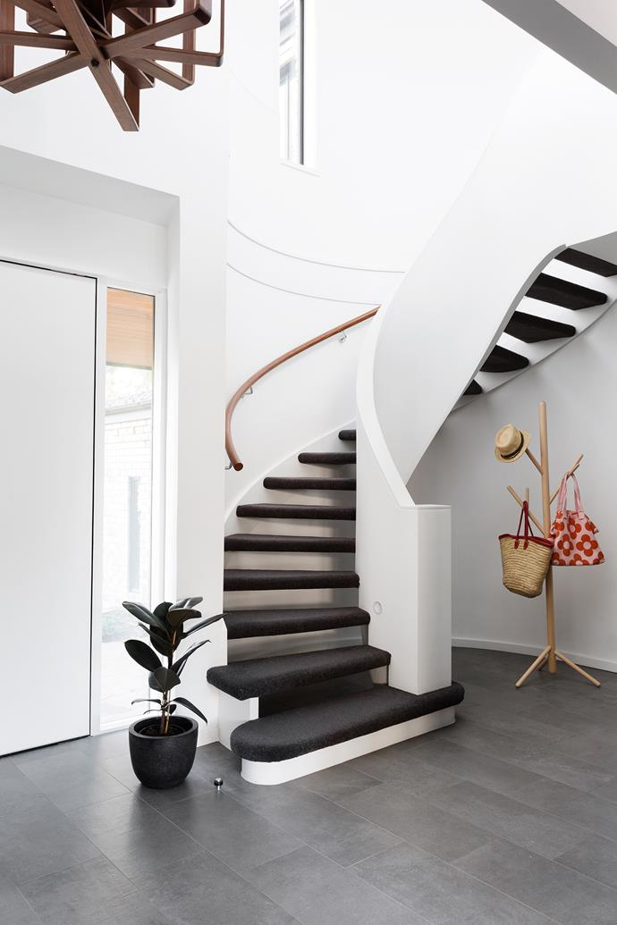 With the treads carpeted, the staircase has become a real feature. Coat stand, from DesignByThem.