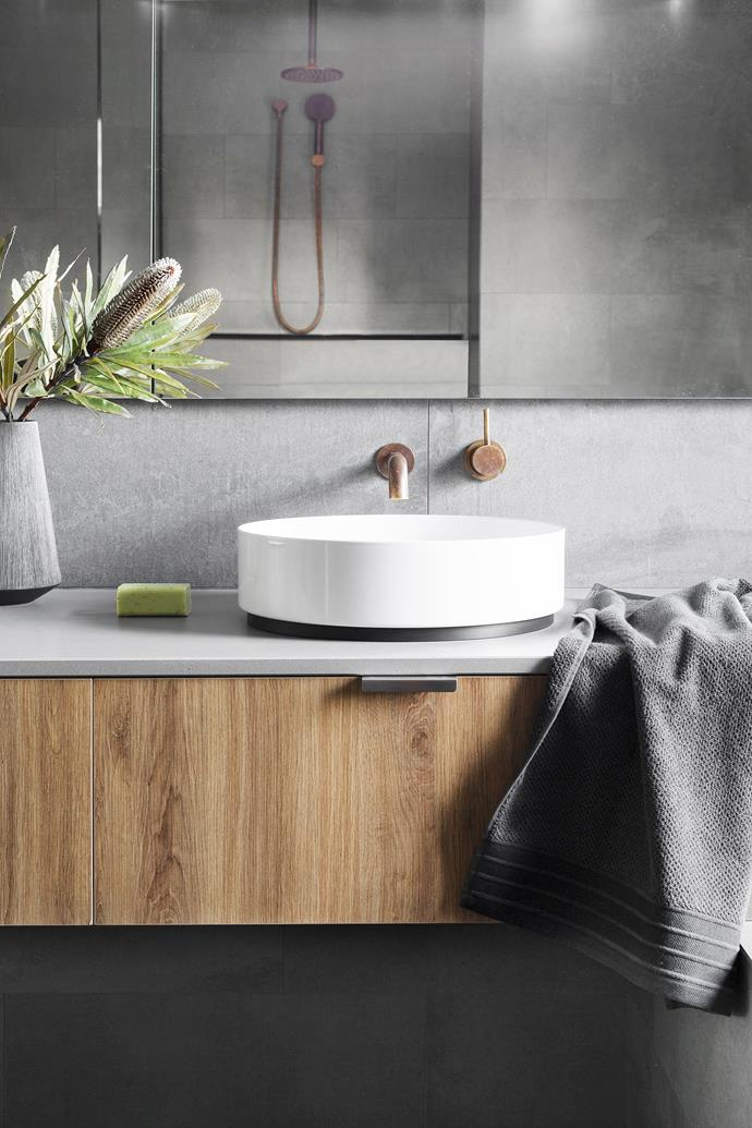 Concrete-look tiles, from Artedomus.  Caesarstone benchtop in Sleek Concrete. Basin, from Reece. Tapware, from Astra Walker.