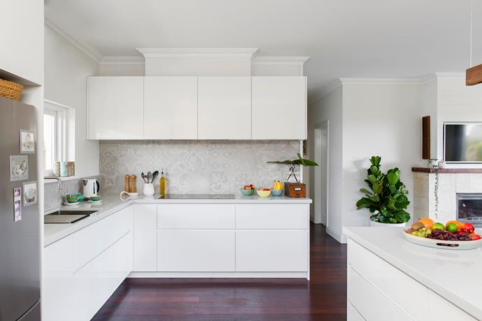 Georgia and Kobi wanted a white kitchen to go with their overall theme and to contrast with the floor.