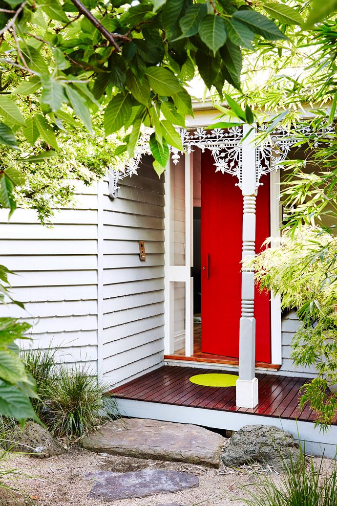 While a new pavilion-style extension lies out the back, the facade was only lightly touched. It's painted Dulux Miller Mood (grey) with Dulux Signal Red on the door.