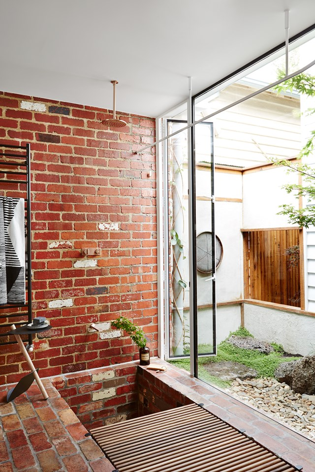 The bathroom opens to a pocket garden with a 'weeping' stone water feature and 'secret' space beyond. *Photo: Annette O'Brien*