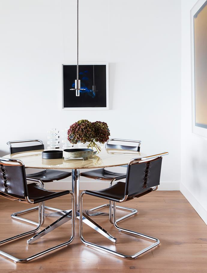 Florence Knoll dining table and Knoll 'Spoleto' chairs with Viabizzuno 'Candela di Vals' light and artworks by unknown artist (centre), and Justine Varga (right).