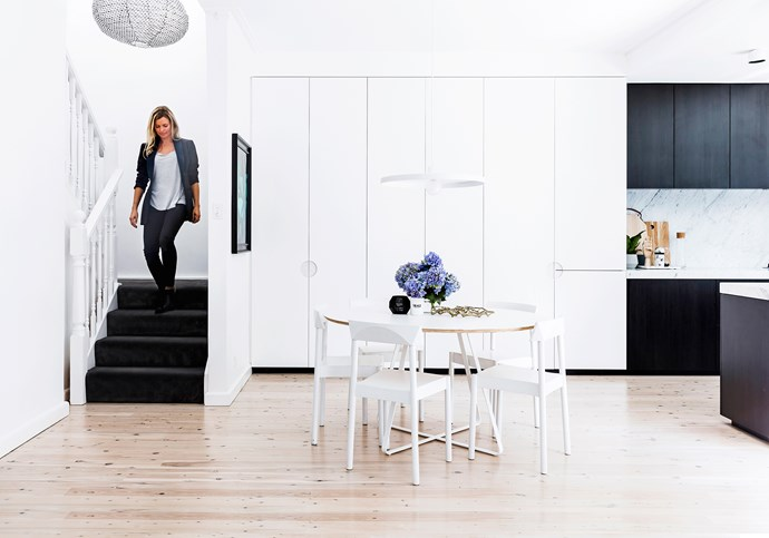 Kristy (pictured) helped to get the right balance in materials and colours in the spaces. The all-white dining room is perfectly bookended by darker kitchen cabinetry and carpeted stairs.